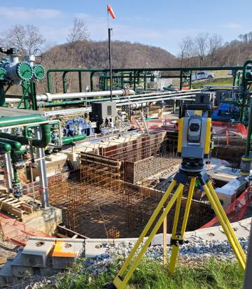 image of survey equipment on industrial job site